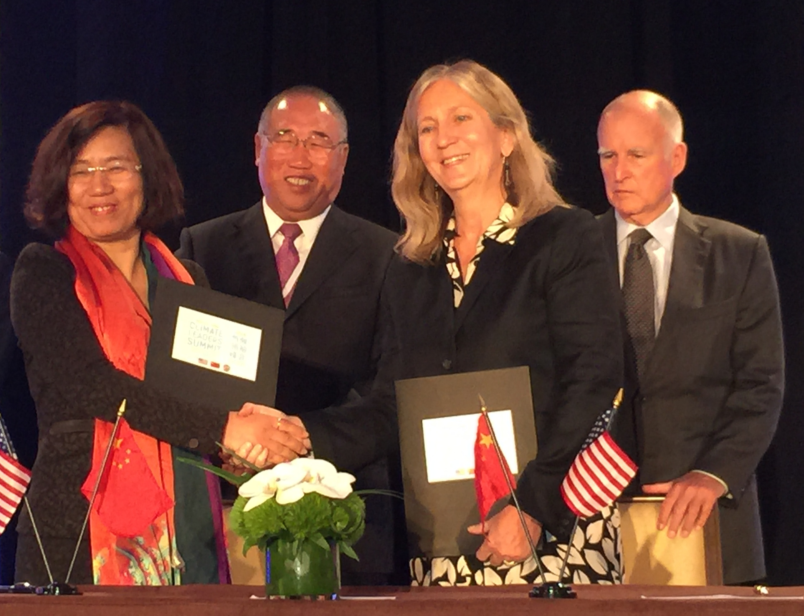 California Gov. Jerry Brown, China Energy Group leader Lynn Price, and members o