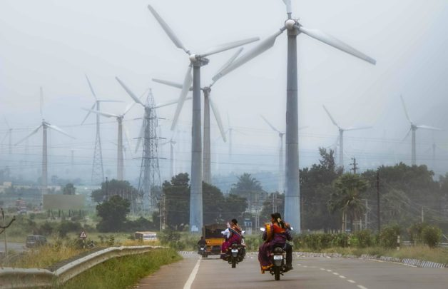Highway and wind turbines in Tamil Nadu, India. India has ambitious scale-up plans for renewable energy over the next decade. (Credit: iStock)