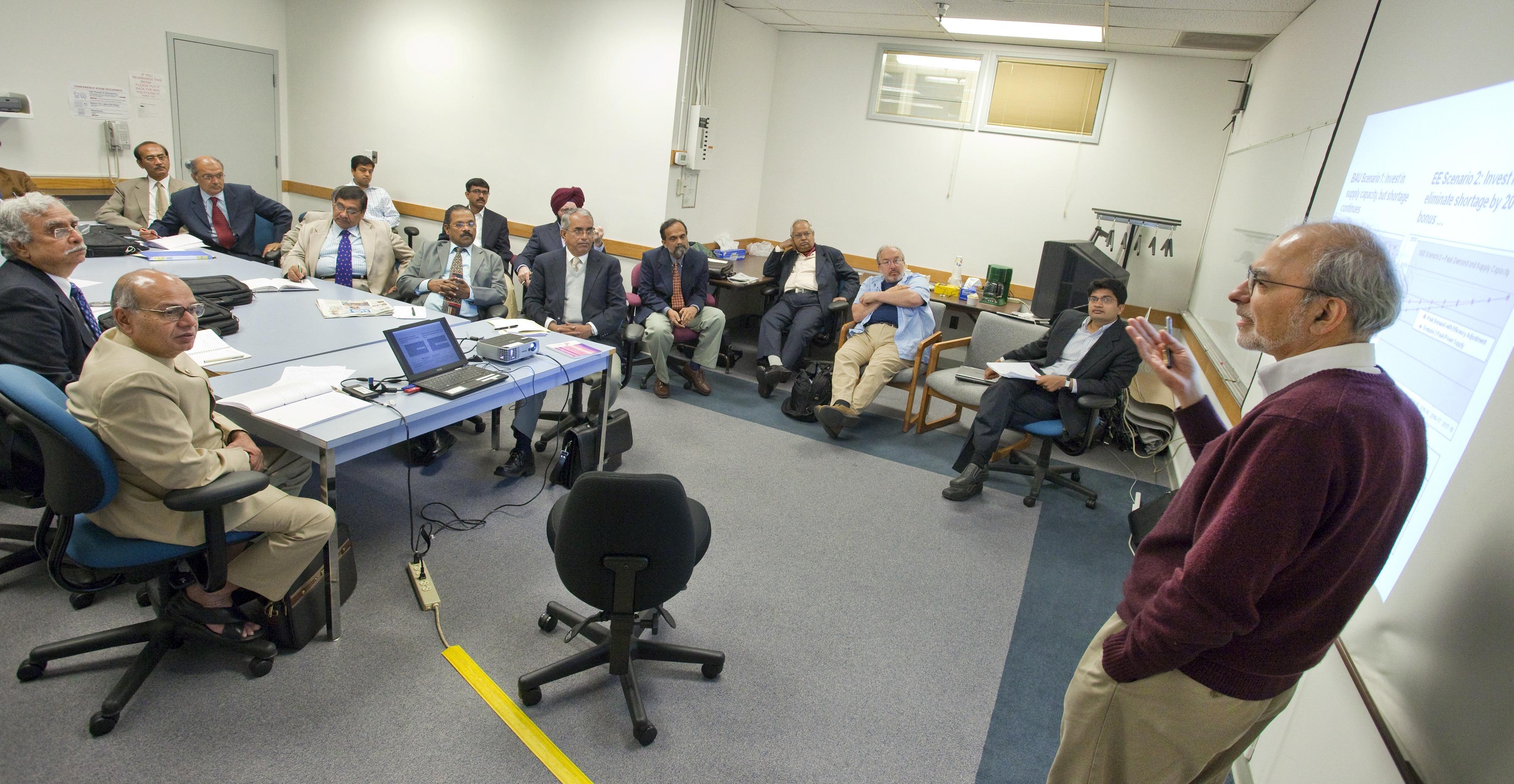 Berkeley Lab scientists Jayant Sathaye and Amol Phadke address a group