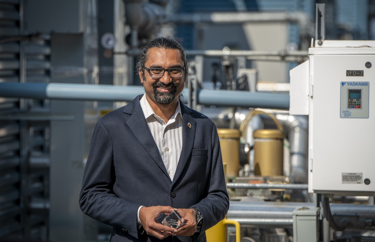 Nihar Shah is recognized worldwide for his expertise in the energy-efficiency of air conditioners and working toward providing affordable cooling for all. Here, he poses with his award from K-CEP. Credit: Thor Swift, Berkeley Lab